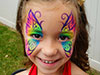 Young girl with her face painted